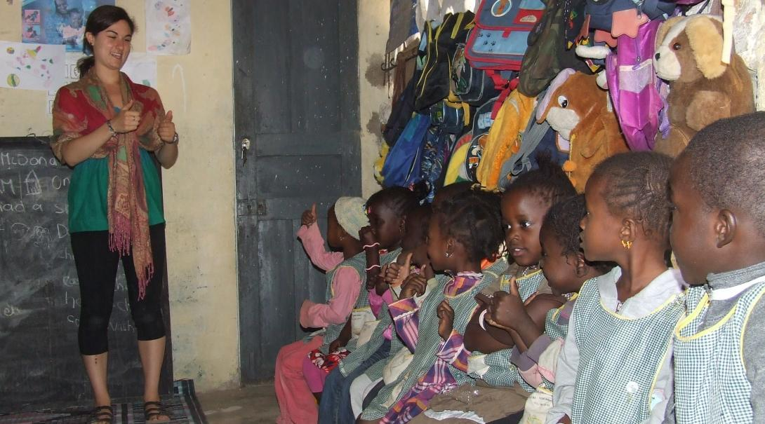 A volunteer with children in Senegal gives a lesson at a kindergarten.